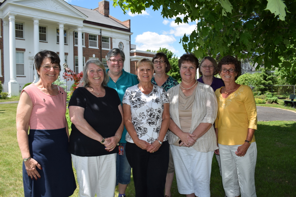 Wells-Ogunquit Community School District staffers, from left, Rachel Kilbride, Jacqueline Sukalas, Raylene Grant, Linda Tipping, Diane Norton, Lillian Lagasse, Sally Marchand and Barbara Stirk recently were honored for their longtime service to the district. Reg Bennett photo