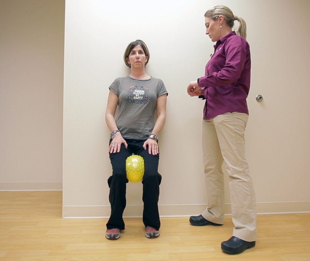 Physical therapist Lydia Cote watches as Meredith Bell performs exercises to build her strength and balance during a physical therapy session at Goodwill NeuroRehab Services in Portland.