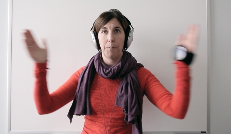 Meredith Bell claps to the beat of a metronome during a physical therapy session at Goodwill NeuroRehab Services in Portland. The exercise uses rhythm and timing to improve her attention and coordination skills.  Bell, 43, is recovering from a traumatic brain injury she suffered when she fell on ice last year.