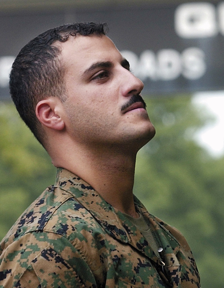 USMC Cpl. Wassef Ali Hassoun is seen in 2004, waiting to make a statement to media outside the Marine base at Quantico, Va.