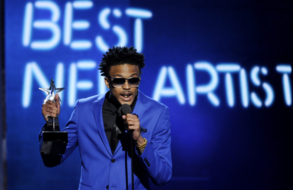 August Alsina accepts the award for best new artist at the BET Awards at the Nokia Theatre in Los Angeles on Sunday.