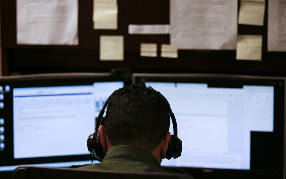A Border Patrol agent in San Diego uses a headset and computer to conduct a long-distance interview by video with a person arrested crossing the border in Texas. With a dramatic increase of Central Americans crossing in South Texas, the Border Patrol is enlisting agents in less busy sectors to process arrests through video interviews.