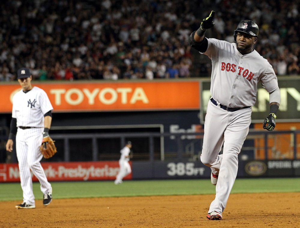 Red Sox designated hitter David Ortiz celebrates while rounding the bases after hitting a three-run home run against the New York Yankees in the third inning at Yankee Stadium on Sunday. Adam Hunger/USA Today