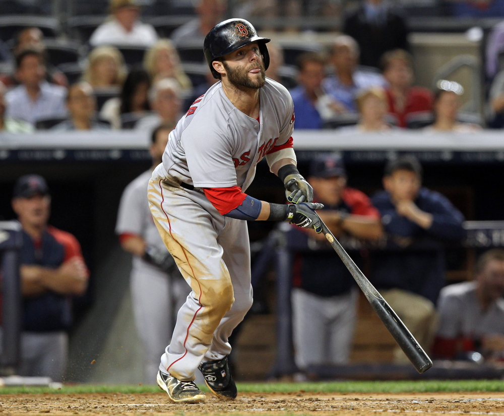 Dustin Pedroia watches his two-run single in the fifth inning Sunday against the New York Yankees. Pedroia went 3 for 3 with three RBI to lead the Red Sox to an 8-5 win.