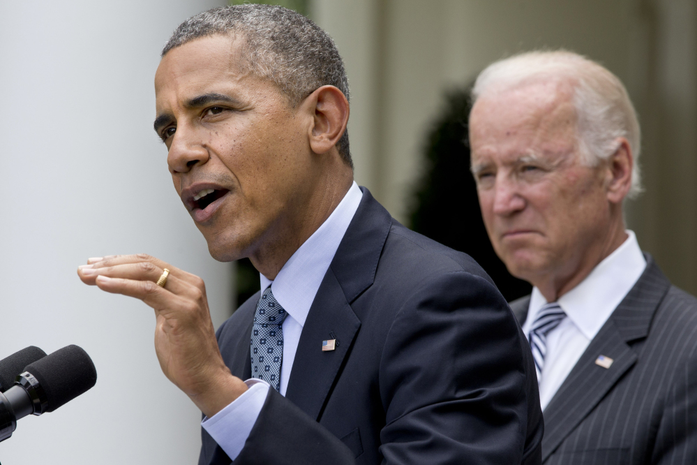 President Barack Obama, accompanied by Vice President Joe Biden, makes an announcement about immigration reform Monday in the Rose Garden of the White House in Washington.