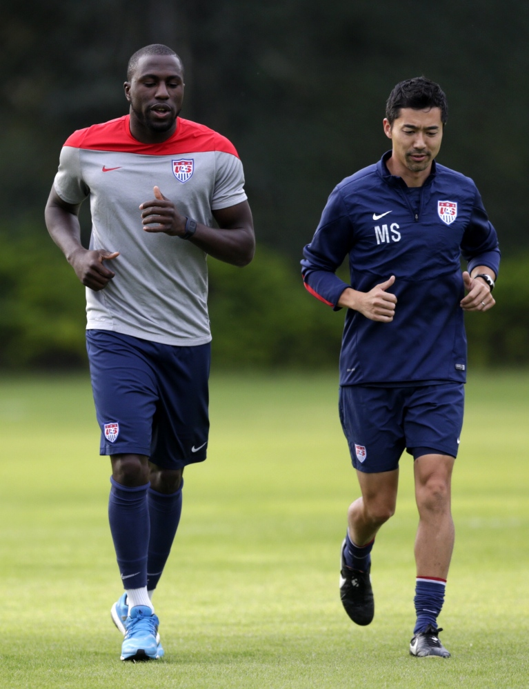 United States' Jozy Altidore, left, works out with trainer Masa Sakihana during a training session in Sao Paulo, Brazil, Saturday, June 28, 2014. The U.S. will play against Belgium in the round 16 of the 2014 soccer World Cup.