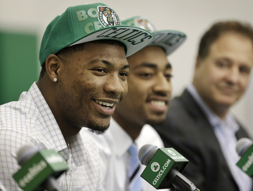 Marcus Smart, left, of Oklahoma State and James Young, center, of Kentucky were selected Thursday in the first round of the NBA draft by the Boston Celtics.