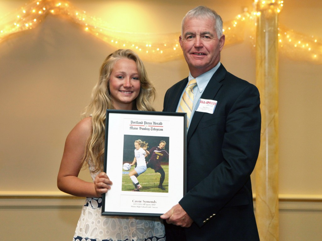 Cassie Symonds of Windham High School receives an award for field hockey from Press Herald sports writer Tom Chard during the 27th Annual All-Sports Awards Sunday. Joel Page/Staff Photographer