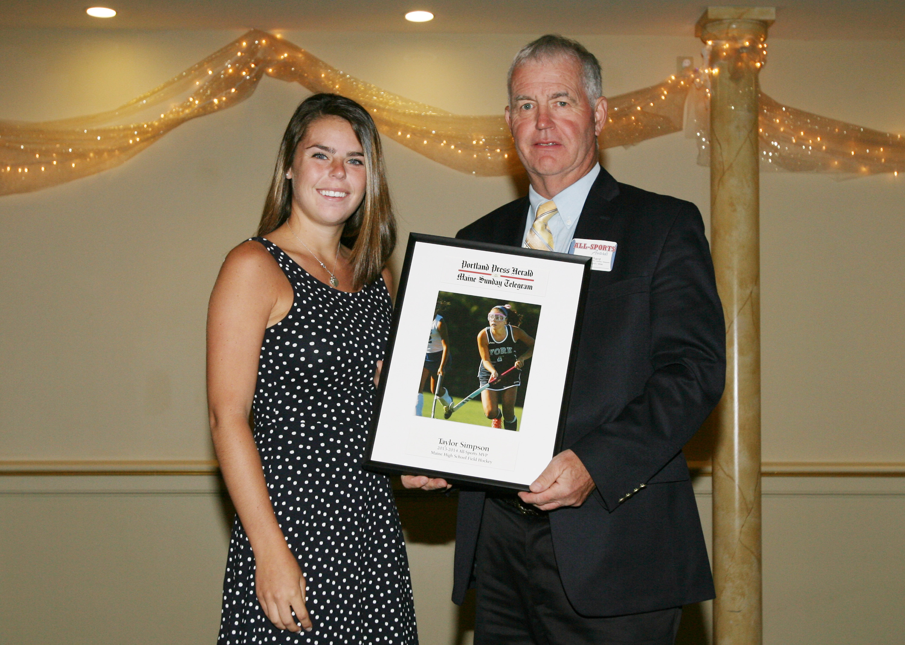 Taylor Simpson of York High School receives an award for field hockey from Press Herald sports writer Tom Chard during the 27th Annual All-Sports Awards Sunday. Joel Page/Staff Photographer