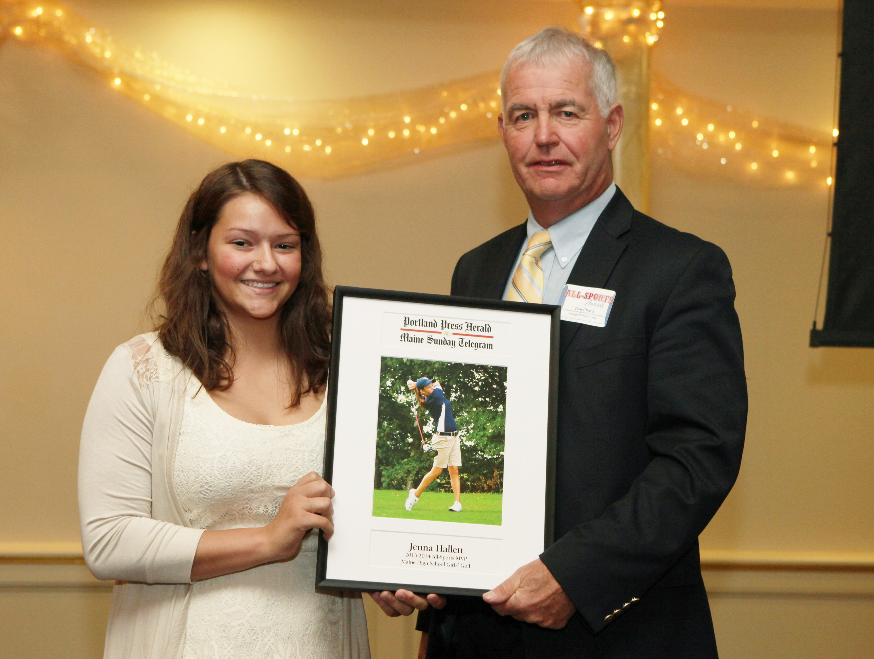 Jenna Hallett of Presque Isle High School receives an award for golf from Press Herald sports writer Tom Chard during the 27th Annual All-Sports Awards Sunday. Joel Page/Staff Photographer