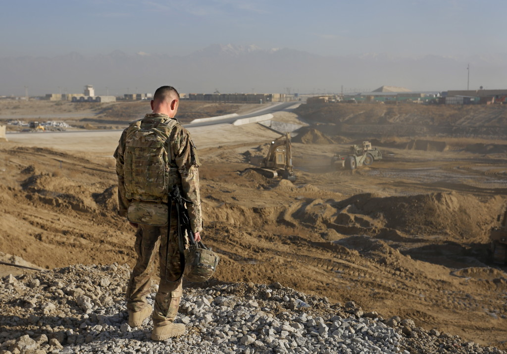 In this December 2013 file photo, Staff Sgt. Jonathan Boubel of Durham takes a moment to himself as he stands at the edge of an old minefield at Bagram Airfield in Afghanistan. The 133rd Engineer Battalion has returned from Afghanistan to the United States.