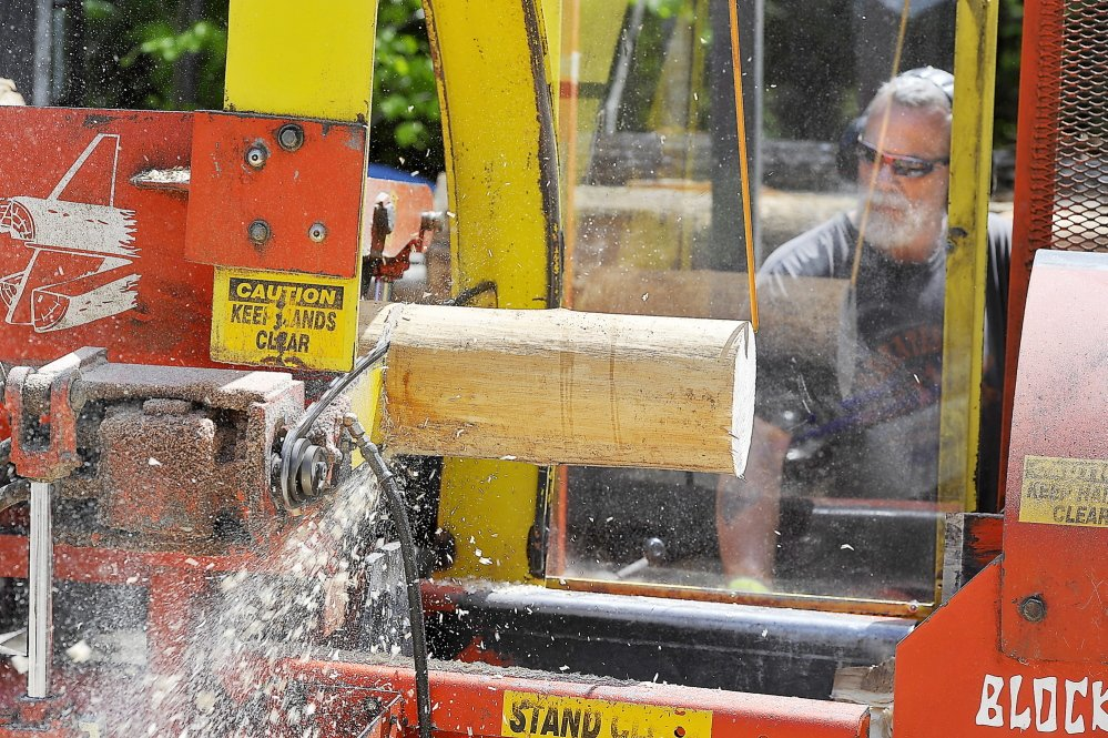 WINDHAM, ME - MAY 21: Mark Killinger, owner of Atlantic Firewood cuts the hardwood logs into smaller sized firewood for sale. (Gordon Chibroski/Staff Photographer)