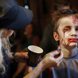 "Ozric Stewart, 7, of Yarmouth gets into his zombie character in hair and makeup before his scene in ""Night of the Living Deb,"" a movie being shot in Portland by local filmmaker Kyle Ranking on Monday. Derek Davis/Staff Photographer"