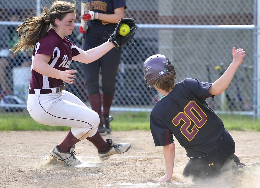 Greely pitcher Miranda Moore takes the throw from the catcher after a passed ball, allowing Sam Feenstra of Cape Elizabeth to score in Monday's softball game at Cape Elizabeth. Cape won, 10-6. Gordon Chibroski/Staff Photographer