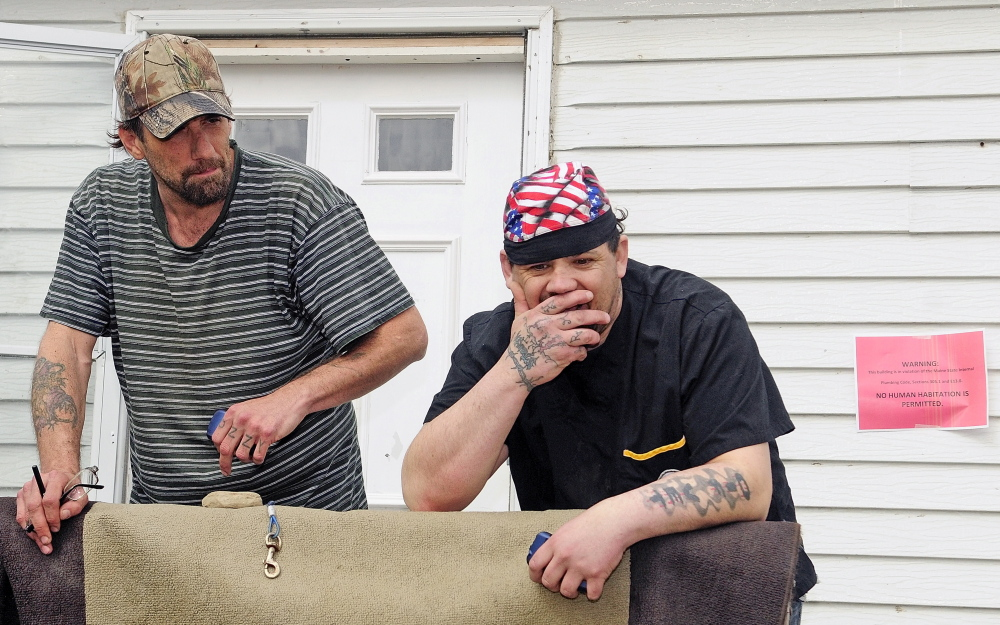 Tyson Joseph Goldstein, left, and Brett Hollowell Sr., say they plan to stay at Meadowbrook Trailer Park now that improvements are in the works. Joe Phelan/Kennebec Journal