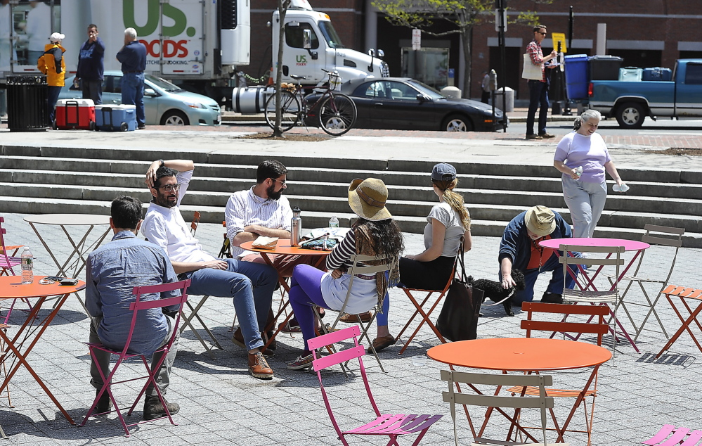 PORTLAND, ME - MAY 29: Day in the life of Congress Square Plaza. Visitors enjoy tables and chairs provided by the Friends of Congress Square Plaza under an agreement with the city. (Photo by Gordon Chibroski/Staff Photographer)