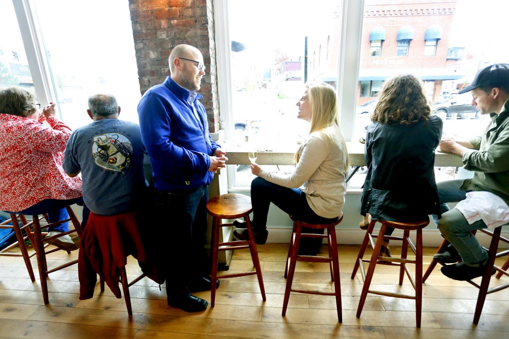 Marc McDonald, 34, and Katie Wasowski, 28, talk at Eventide Oyster Co. in Portland on Friday night on May 16, 2014. The couple live together in Portland and have been together since February of 2013. Tim Greenway/Staff Photographer