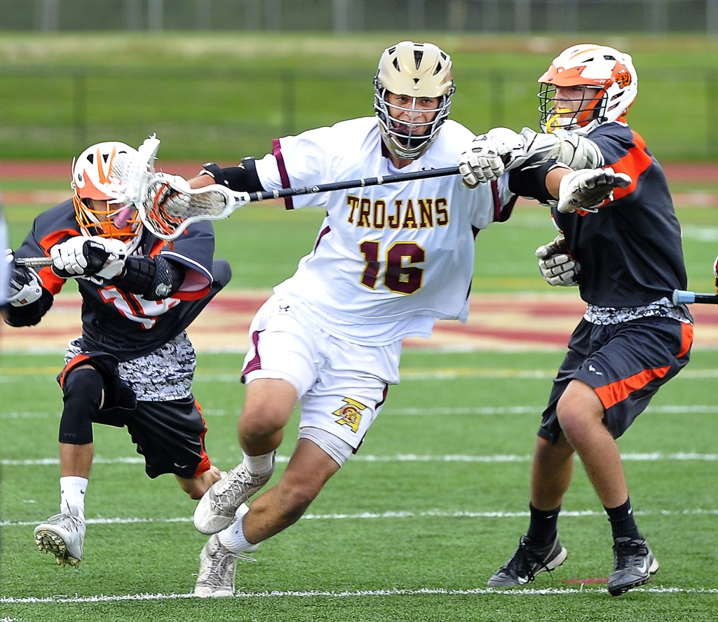Taylor Browne of Thornton Academy tries to power his way upfield through the Biddeford defense on Wednesday during the Trojans' 15-1 quarterfinal win. Gordon Chibroski/Staff Photographer