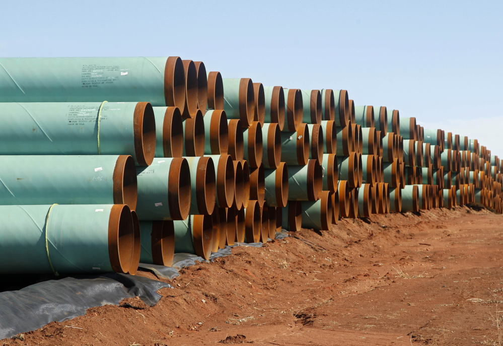 Miles of pipe ready to become part of the Keystone Pipeline are stacked in a field near Ripley, Okla. 2012 Associated Press file photo