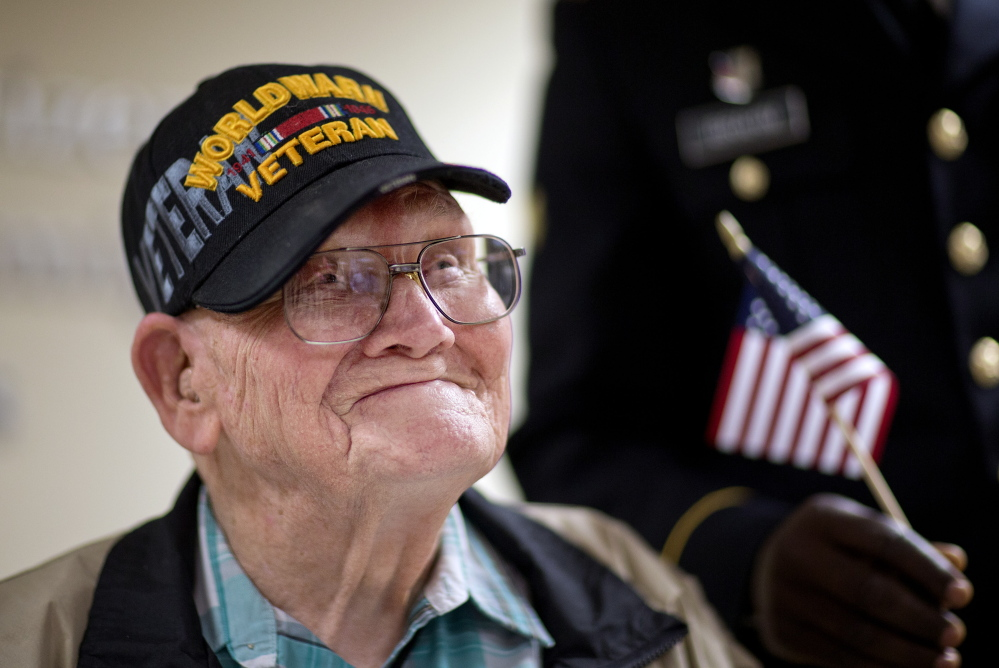 World War II veteran Sherwin Callander, 94, talks to the media Monday after his naturalization ceremony in Atlanta. He is headed to France for D-Day ceremonies. The Associated Press