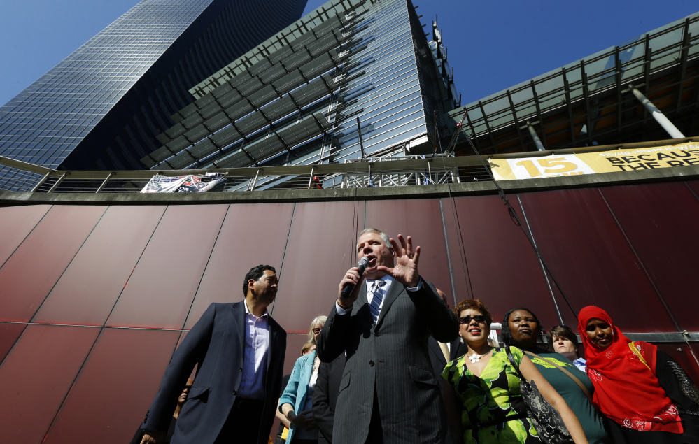 The Associated Press/Ted S. Warren Seattle Mayor Ed Murray, center speaks Monday, June 2, 2014, at a rally outside Seattle City Hall after the Seattle City Council passed a $15 minimum wage measure in Seattle.