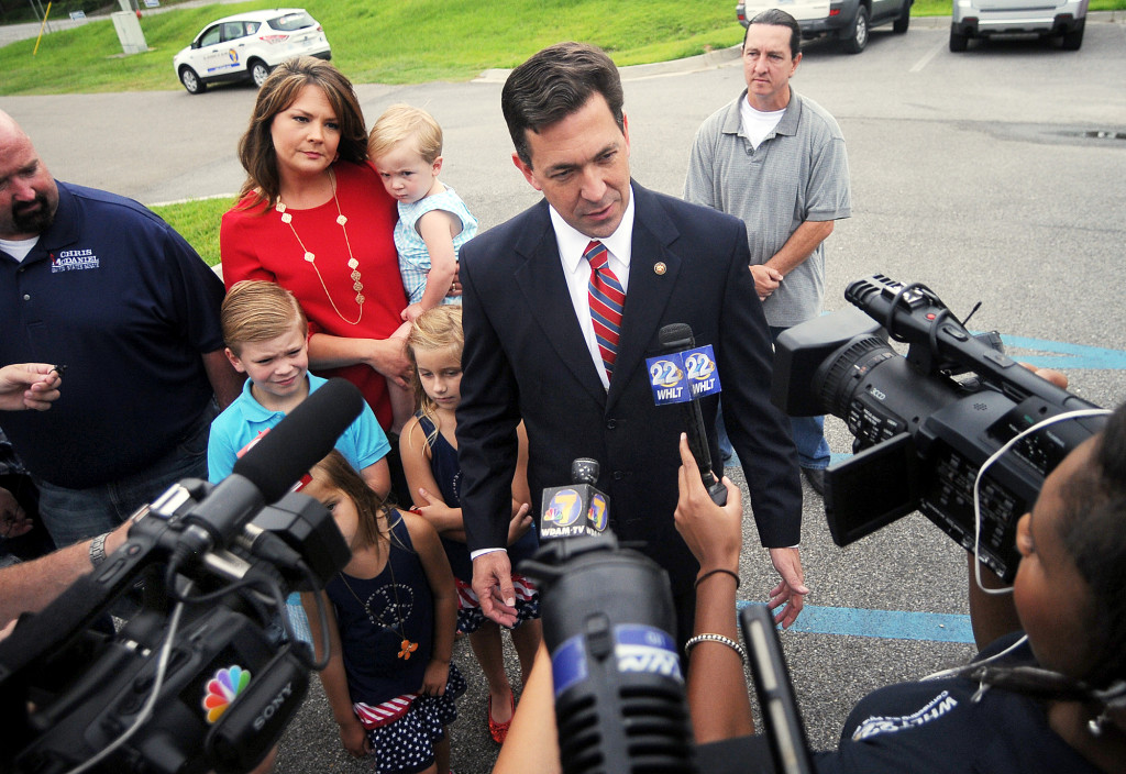 State Sen. Chris McDaniel speaks with the media before voting at the George Harrison Building, Tuesday, June 24, 2014, in Ellisville, Miss.
