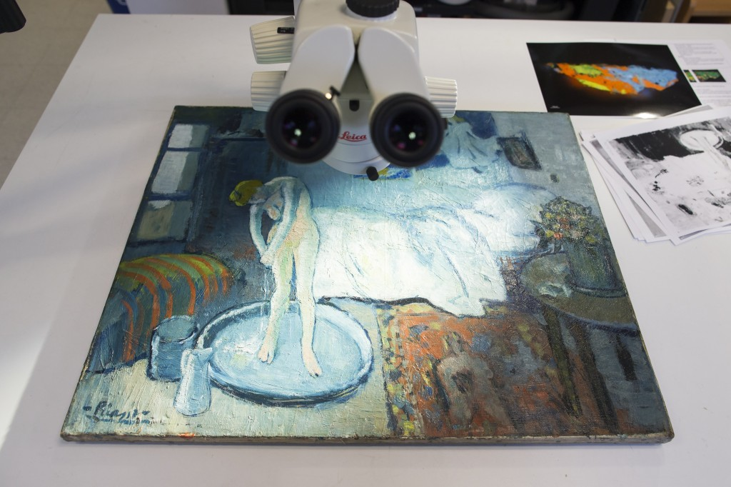 """The Blue Room,"" one of Pablo Picasso's first masterpieces, sits under a microscope at The Phillips Collection on June 10 in Washington. The Associated Press"