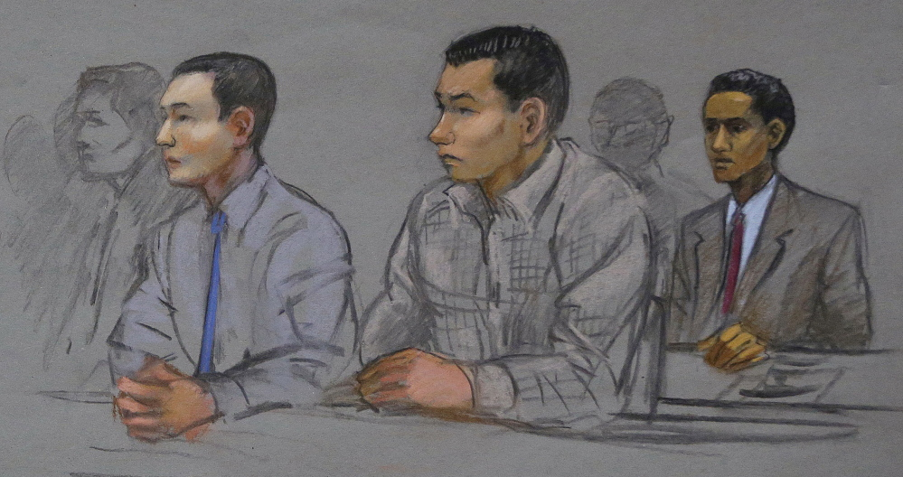 The Associated Press This courtroom sketch shows defendants Azamat Tazhayakov, left, Dias Kadyrbayev, center, and Robel Phillipos, right, college friends of Boston Marathon bombing suspect Dzhokhar Tsarnaev, during a hearing in federal court Tuesday in Boston.