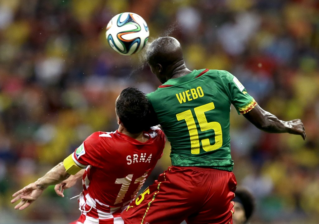 Cameroon's Pierre Webo, right, and Croatia's Darijo Srna battle for the ball during a group A World Cup soccer match Wednesday.