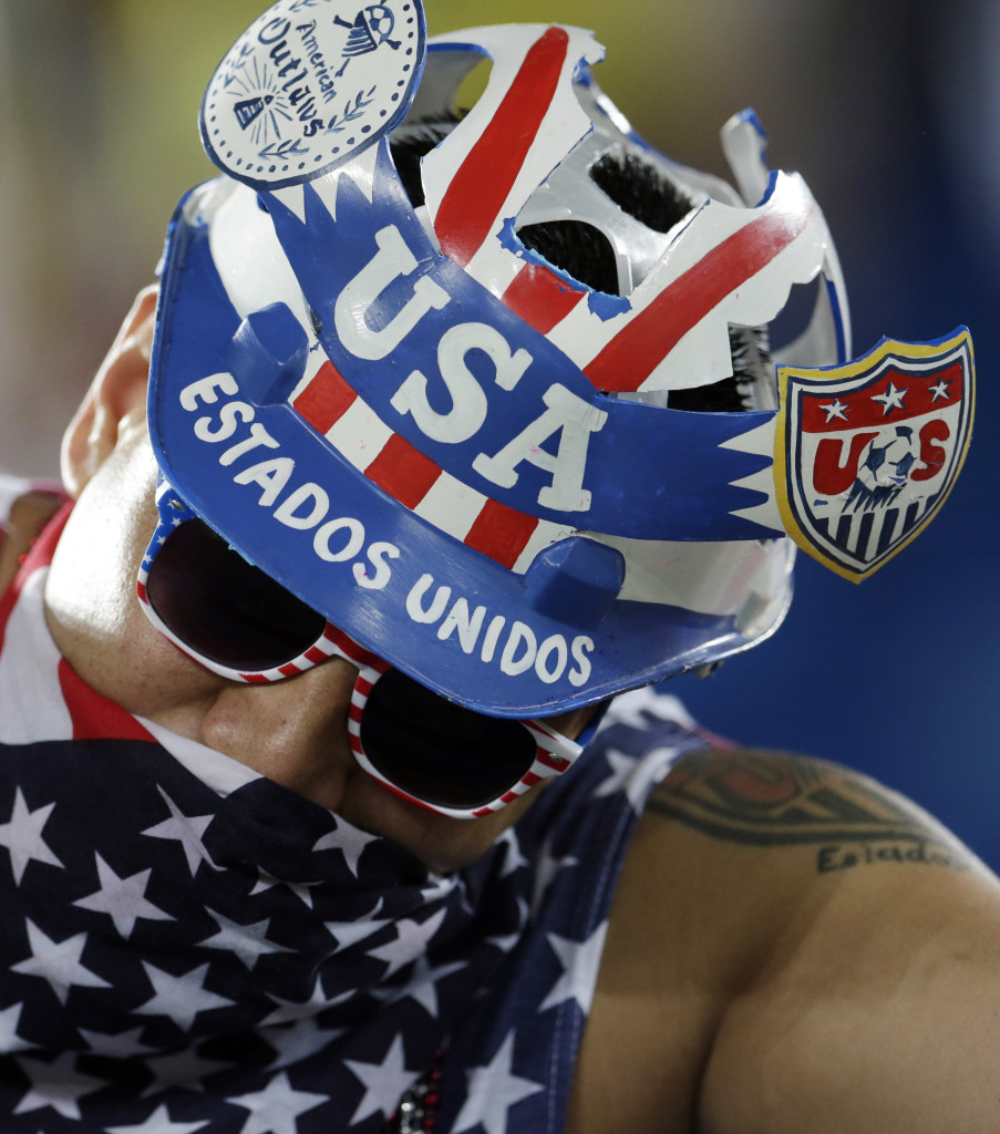 An American fan shows off his headwear before the group G World Cup soccer match between Ghana and the United States at the Arena das Dunas in Natal, Brazil, Monday, June 16, 2014.
