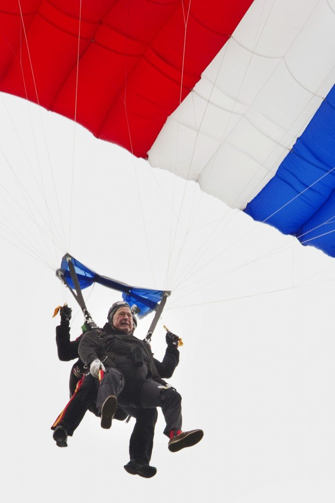 Former President George H. W. Bush celebrated his 90th birthday with a tandem skydive, landing on the lawn of St. Anne's church in Kennebunkport.