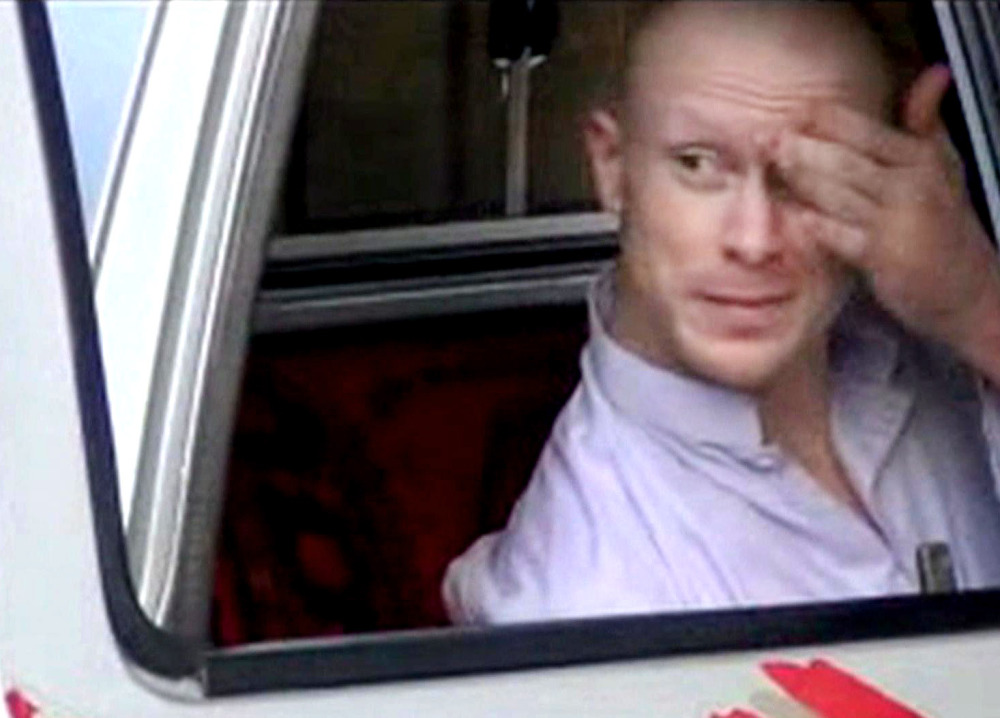 In this image taken from video, which has been authenticated based on its contents and other AP reporting, Sgt. Bowe Bergdahl sits in a vehicle guarded by the Taliban in eastern Afghanistan prior to his release Saturday. The Associated Press/Voice of Jihad website