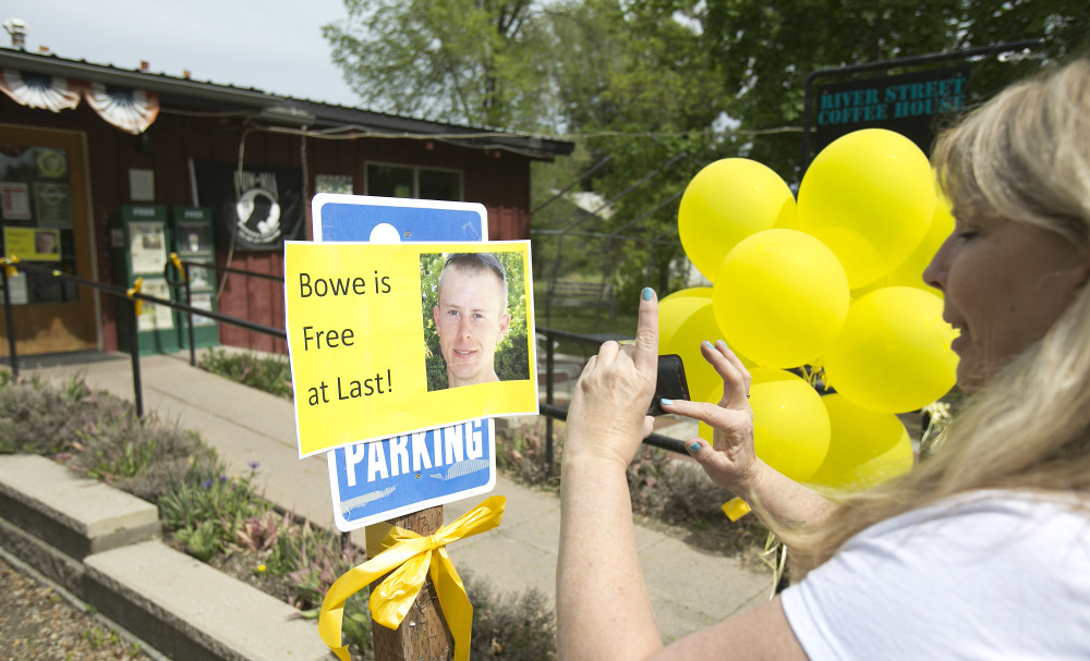 Diane Walker takes a picture of a sign celebrating U.S. Army Sgt. Bowe Bergdahl's release in front of Zaney's coffee shop in Hailey, Idaho. The Associated Press