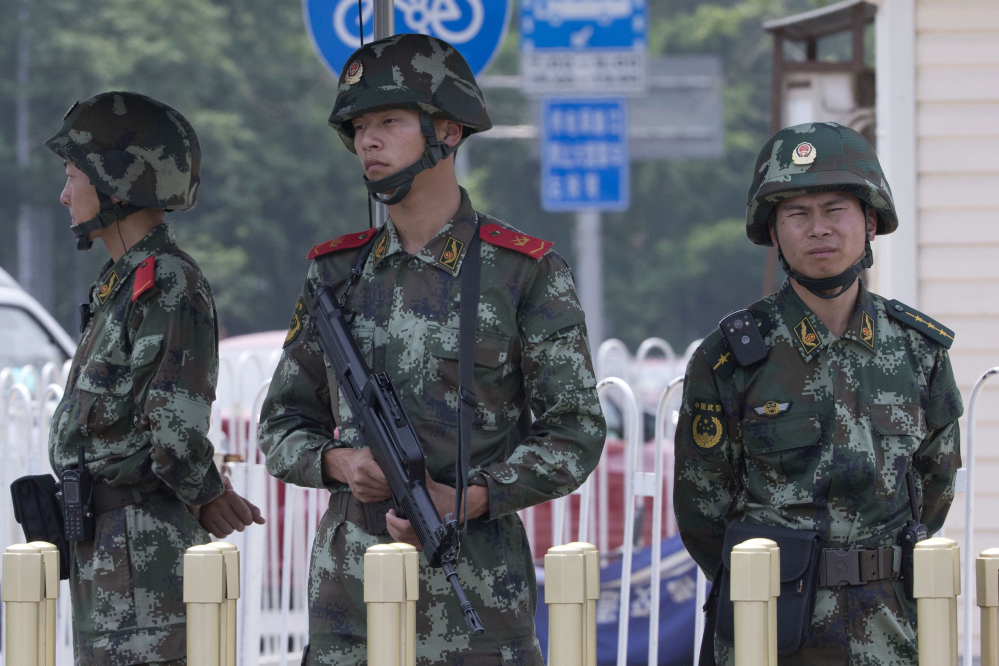 Chinese paramilitary police man a security checkpoint on Tiananmen Square in Beijing on Wednesday, the 25th anniversary of the brutal crackdown on student protesters. The Associated Press