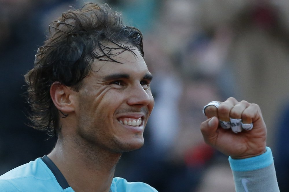 The Associated Press Spain's Rafael Nadal celebrates winning the quarterfinal match of the French Open tennis tournament against compatriot David Ferrer in Paris, France, on Wednesday.
