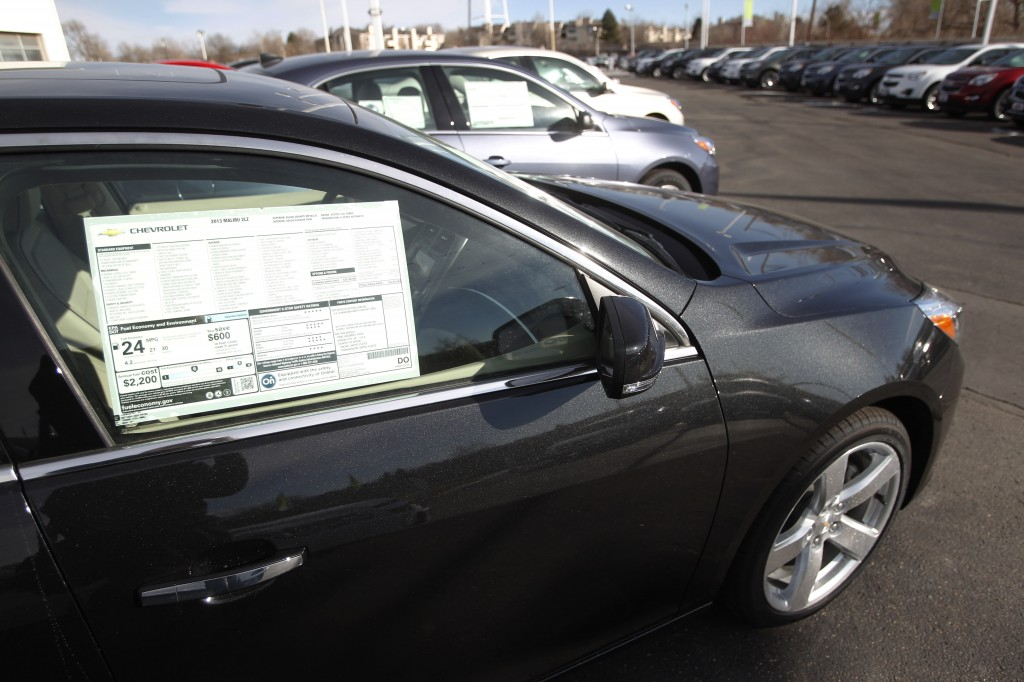 In this January 2013 photo, 2013 Chevrolet Mailbus sit at a Chevy dealership in Englewood, Colo. Cars such as the Malibu have retained or increased their value, sometimes more than rival vehicles in the same market segment.
