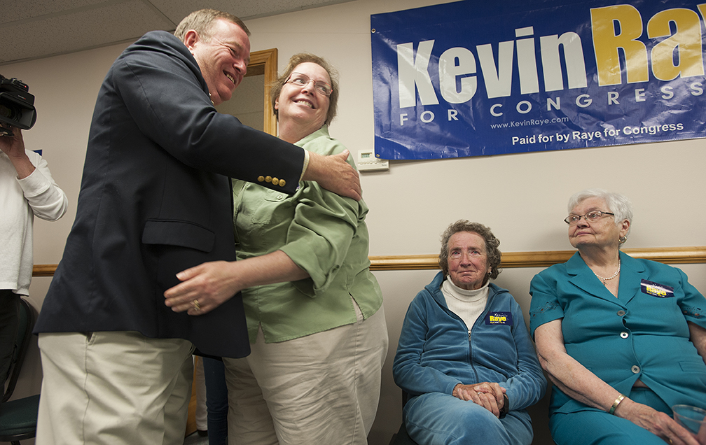 Kevin Raye hugs his sister-in-law Cathy Terrill as he thanks family members including his mother Francis Raye, center, and his mother-in-law, Barbara Howard, right, after telling supporters that he would not win the District 2 Congressional seat. Kevin Bennett Photo