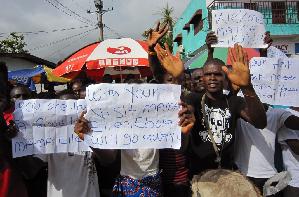 "People protest outside a hospital after Ebola deaths in Monrovia, Liberia. A senior official for Doctors Without Borders says the current Ebola outbreak ravaging West Africa is ""totally out of control"" and that the medical group is stretched to the limit in its capacity to respond."