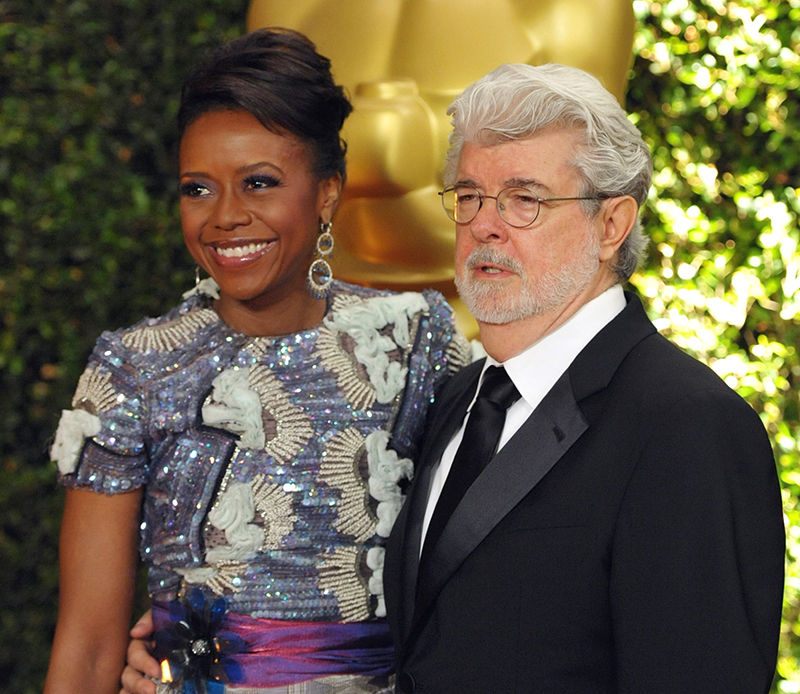 Filmmaker George Lucas and his wife, Chicago native Mellody Hobson, arrive for at the 2013 Governors Awards in Los Angeles. File Photo/The Associated Press