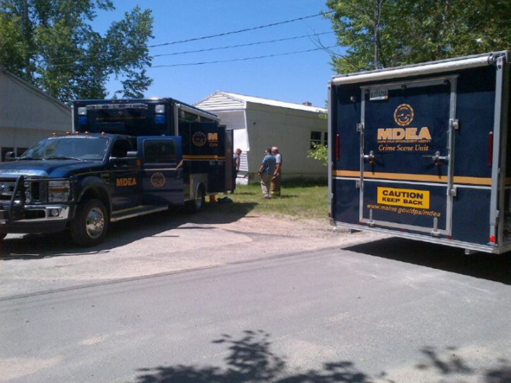 A police team gathers at a suspected methamphetamine lab on Stone Road in Newfield on Tuesday, June 3, 2014. Courtesy Maine Drug Enforcement Agency
