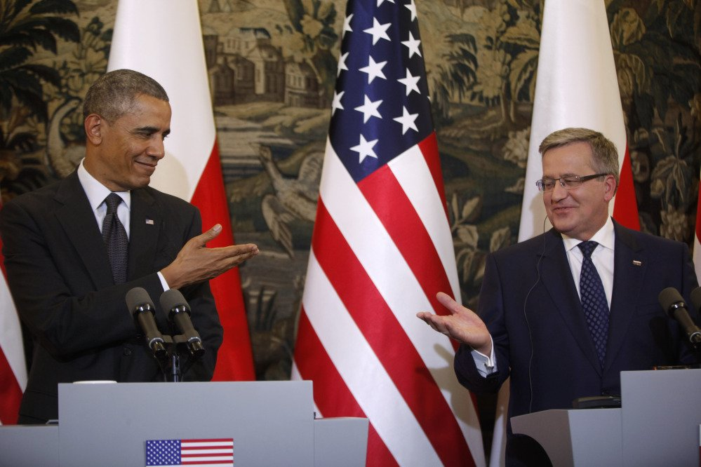The Associated Press As President Obama called Tuesday for a heavier U.S. military presence in Europe, Poland President Bronislaw Komorowski, right, said his country intends to increase its defense budget.
