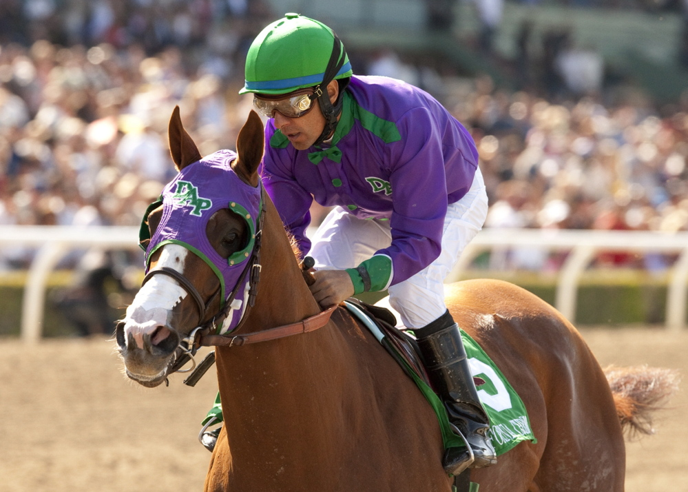2014 Associated Press File Photo/Benoit Photo California Chrome, ridden by jockey Victor Espinoza, is shown winning the Santa Anita Derby horse race in Arcadia, Calif. California Chrome is favored to win the Belmont Stakes on Saturday.