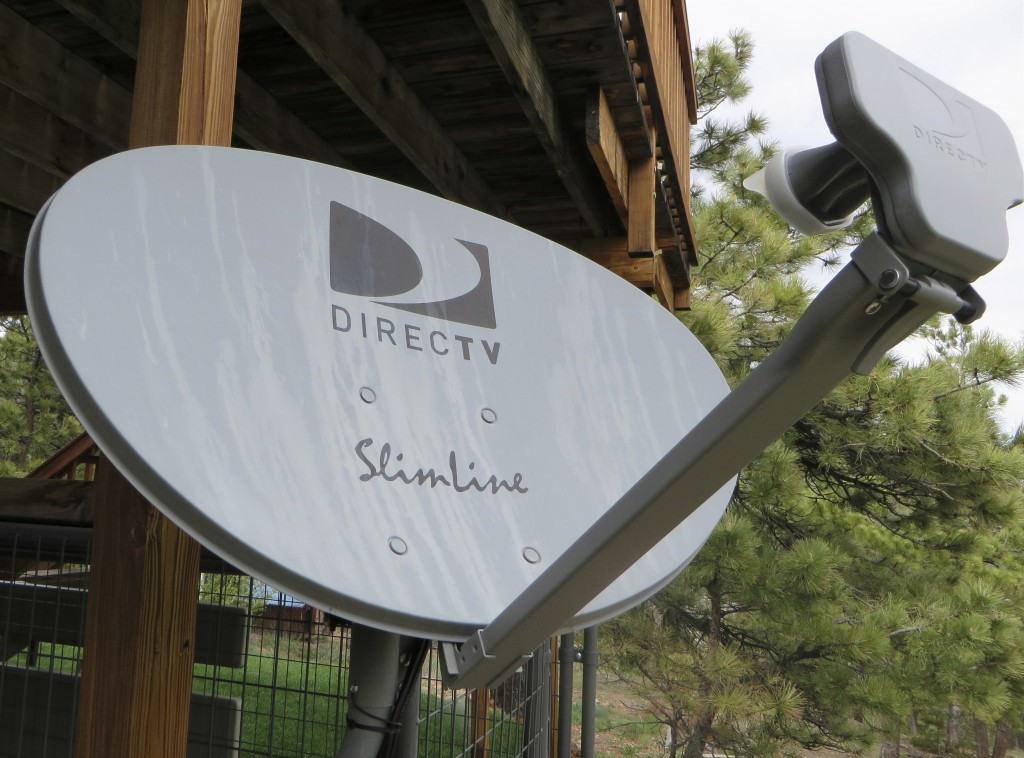 A DirecTV satellite dish is seen on a home outside Golden, Colo., in May. Reuters