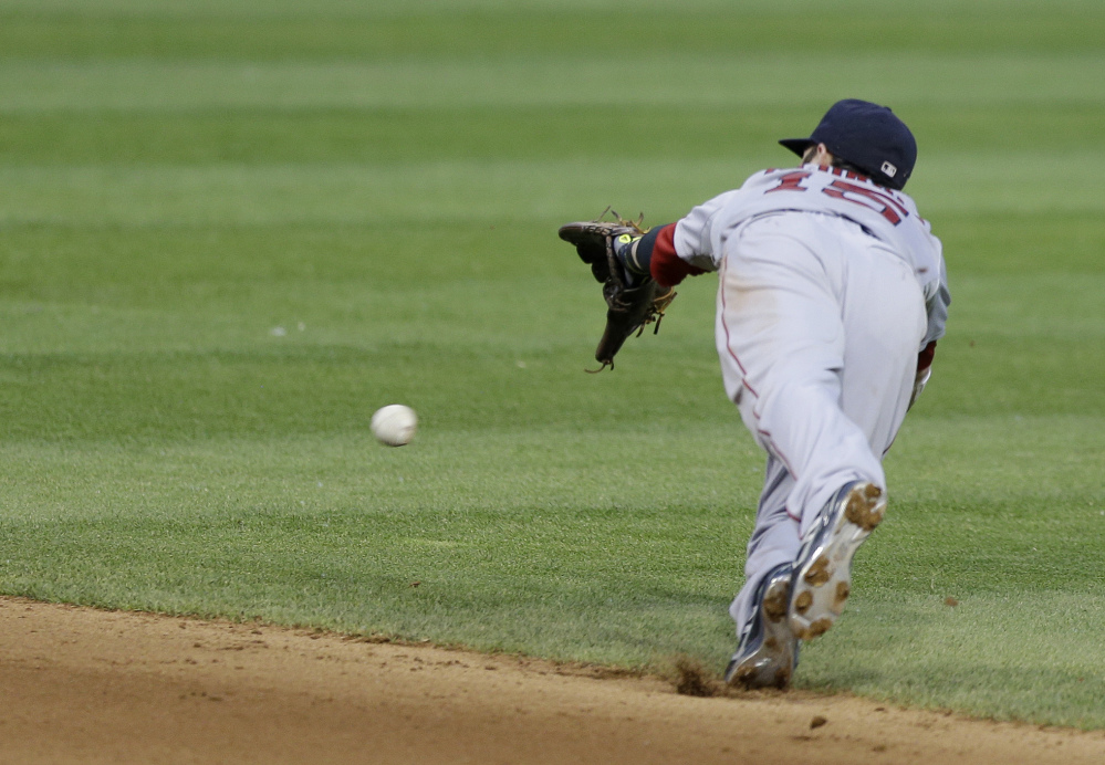 Boston Red Sox's Dustin Pedroia dives but can't get to a single hit by Cleveland Indians' David Murphy in the inning of a baseball game, Monday, June 2, 2014, in Cleveland. The Indians defeated the Red Sox 3-2. (AP Photo/Tony Dejak)