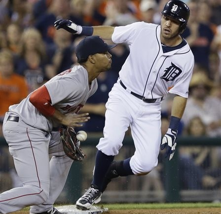 Tigers second baseman Ian Kinsler beats the throw to Red Sox third baseman Xander Bogaerts for an RBI triple in the sixth inning Saturday in Detroit. The Associated Press