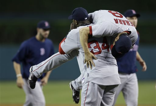 Boston Red Sox designated hitter David Ortiz lifts relief pitcher Koji Uehara after the ninth inning against the Detroit Tigers in Detroit on Sunday. The Associated Press