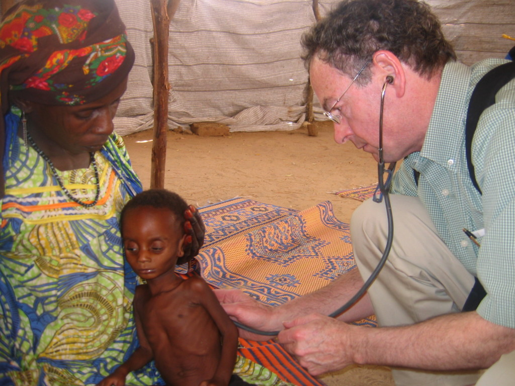 Dr. Richard Rockefeller examines a patient in Nigeria in 2009.