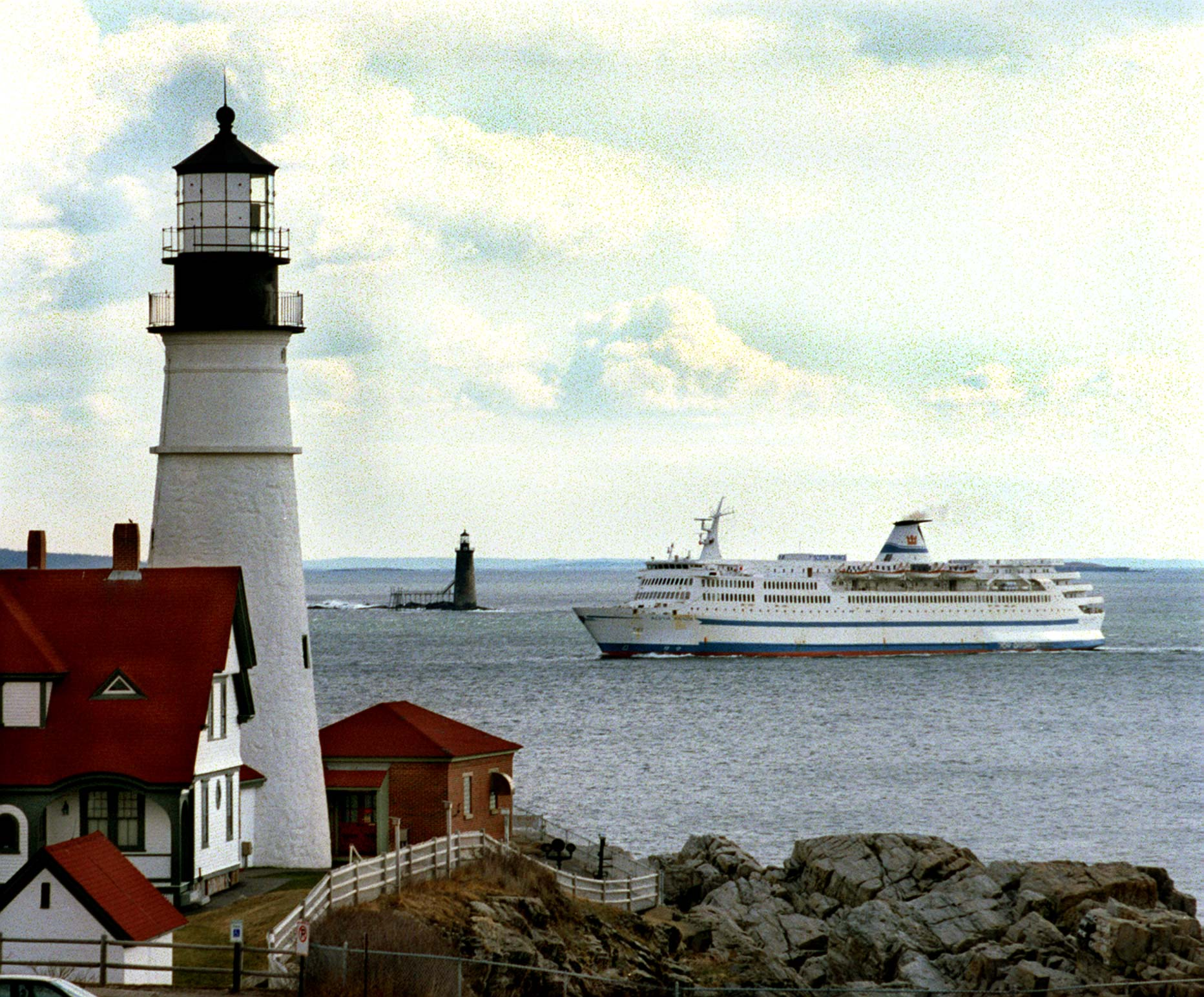 The Scotia Prince returns to Portland for the summer season on April 8, 1997. In the foreground is Portland Head light and Ram Is. light is in the background.