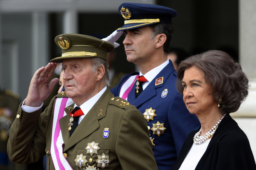 In this Jan. 6, 2014, file photo, Spain's Crown Prince Felipe, center, Spain's King Juan Carlos, left, and Spain's Queen Sofia, right, attend the annual Pascua Militar Epiphany ceremony at the Royal Palace in Madrid. The Associated Press