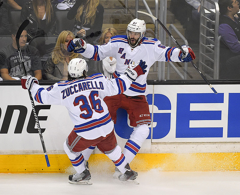 New York Rangers left wing Benoit Pouliot, right, celebrates his goal with right wing Mats Zuccarello, of Sweden, against the Los Angeles Kings during the first period in Game 1 of the NHL hockey Stanley Cup Finals, Wednesday The Associated Press